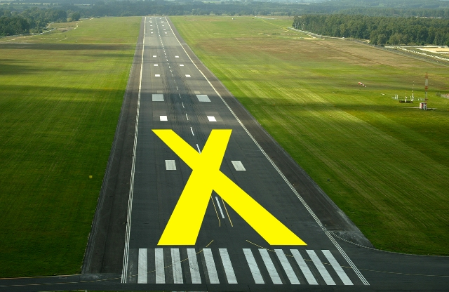 Airport Runway Markings With A Big Yellow X On The Runway