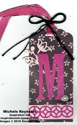 Large letters framelits m tag watermark