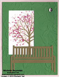 Sheltering tree cherry blossom bench watermark
