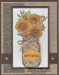 Jar of flowers with in color enamel dots