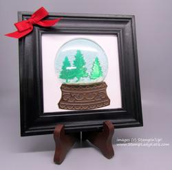 Shaker snowglobe in a frame