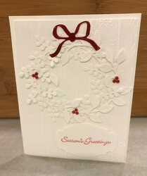 Arrange a wreath in white card