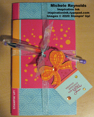 Gift wrapped notebooks and pen tag