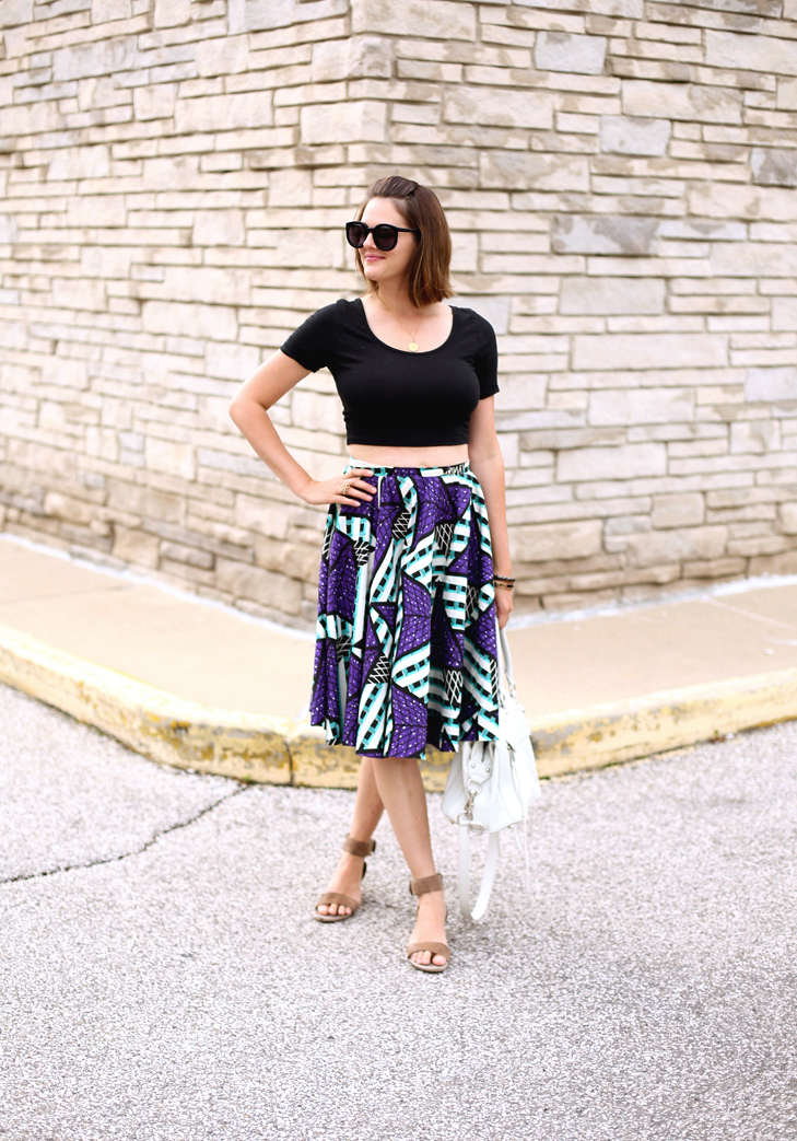 Jessica Quirk wears a self made wax print circle skirt with a crop top.