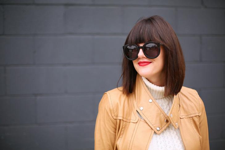 cream sweater, camel leather jacket, black skirt, booties