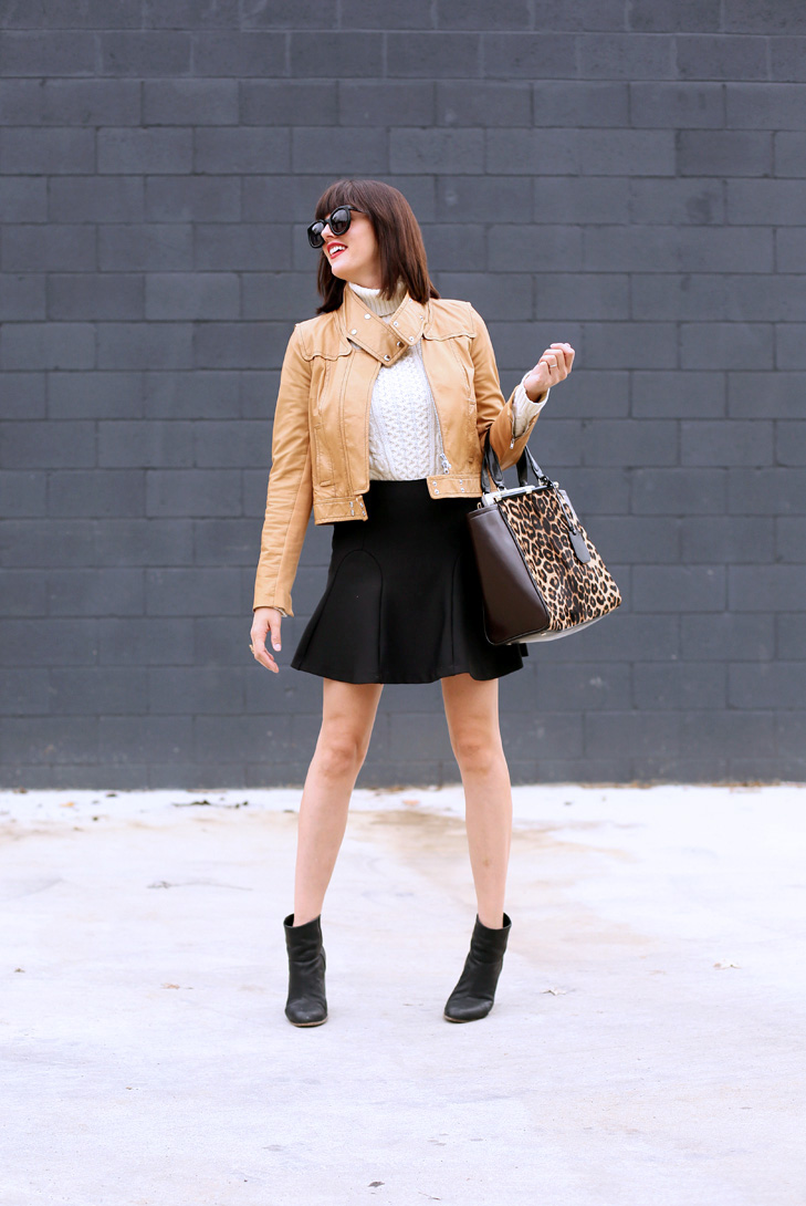 cream sweater, camel leather jacket, black skirt, booties