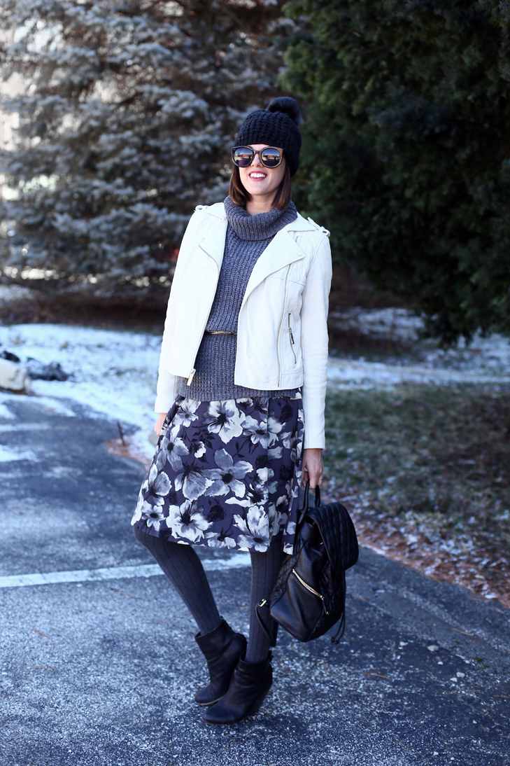 Jessica Quirk layers a vintage inspired dress with sweater vest and moto jacket