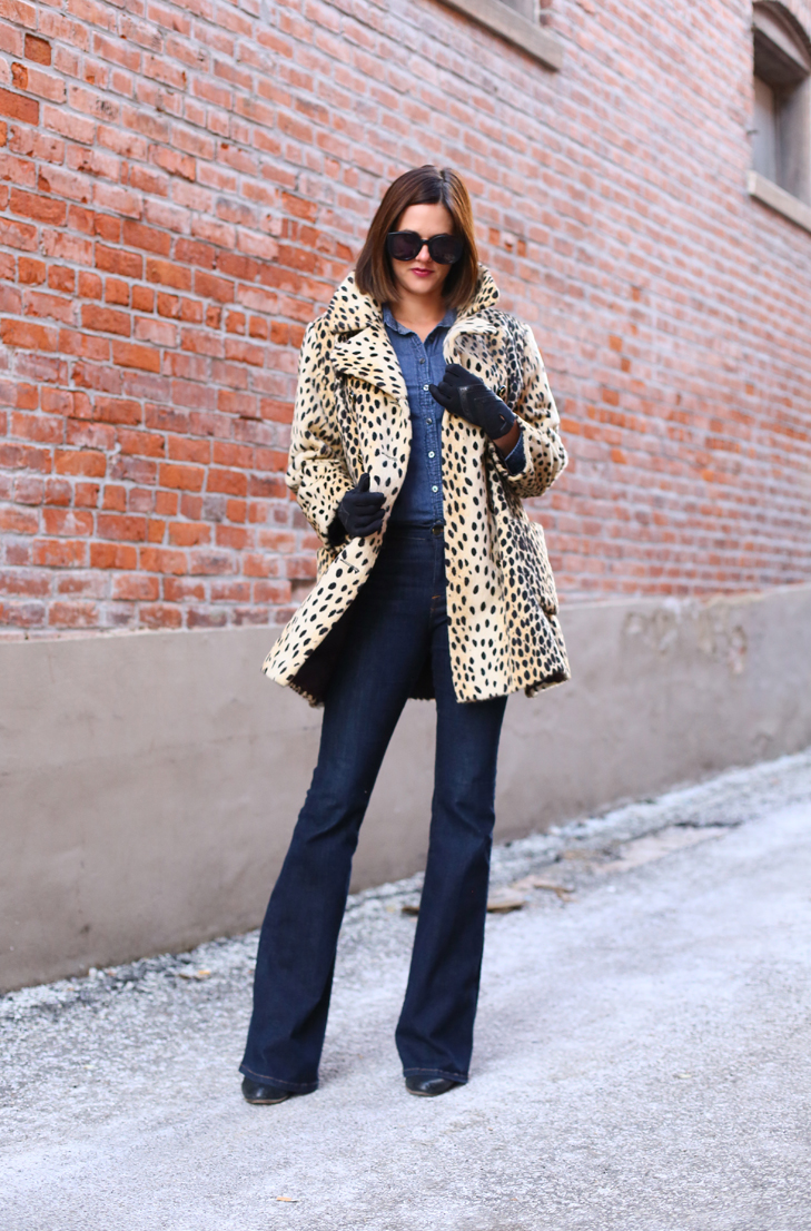 Jessica Quirk styles a vintage cheetah print coat with flare denim and a chambray button down