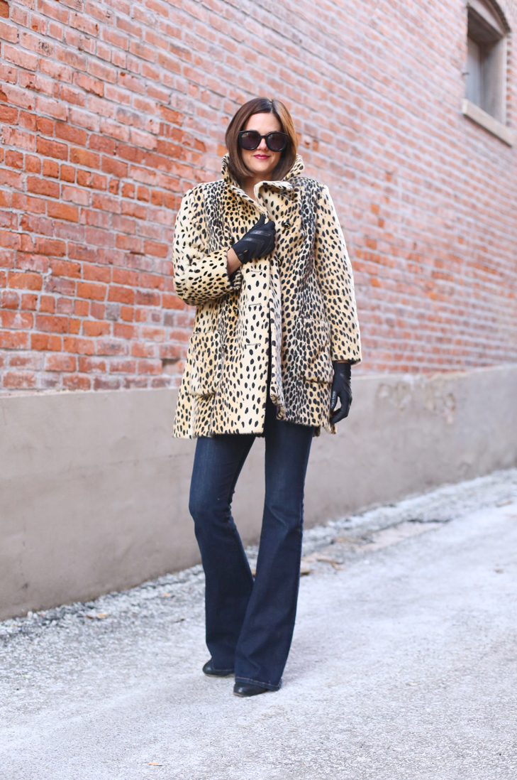 Jessica Quirk wears a vintage cheetah print coat with flare jeans and a chambray button down