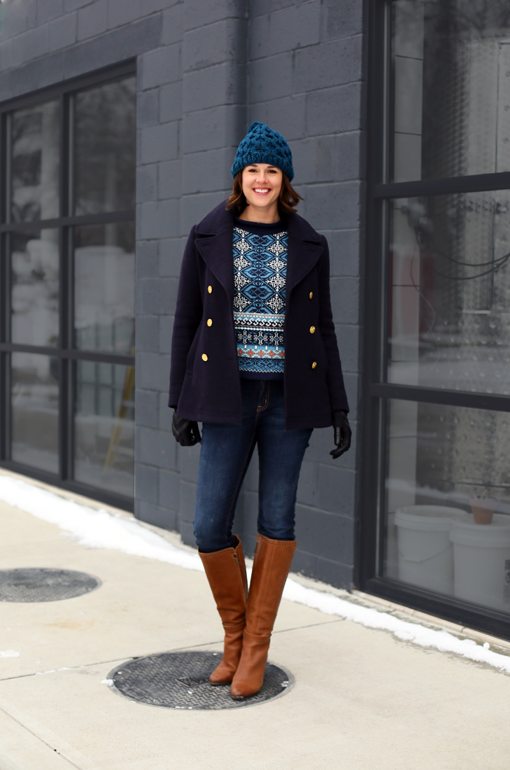 Jessica Quirk wears a thrift store sweater with peacoat, jeans and over the knee boots.