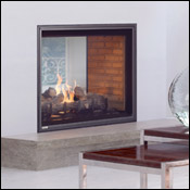 Black see-through penisula fireplace in a warm wood finished frame