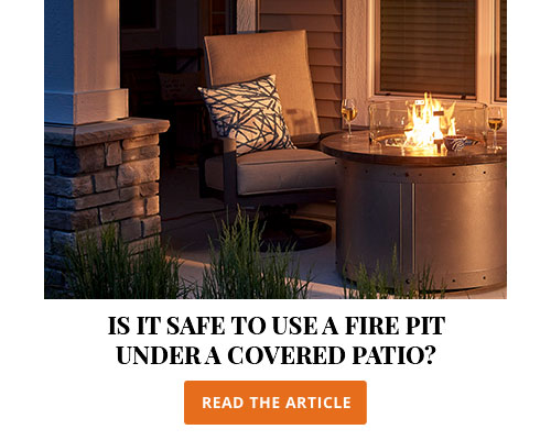 Is it safe to use a fire pit under a covered patio?