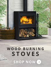 Traditional, black wood stove with blazing yellow fire inside and black