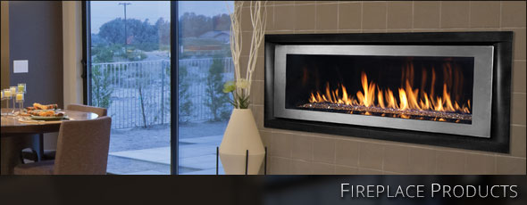Black linear gas fireplace surrounded by a gray tiled wall in a contemporary dining room