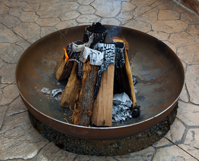 Logs and kindling for wood burning fire pit