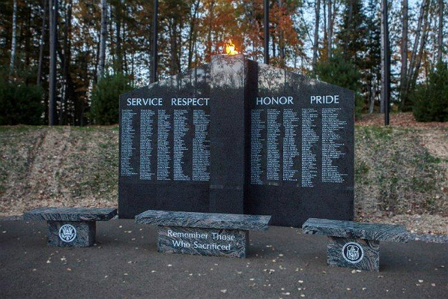 Large dark gray ganite veteran memorial in the woods
