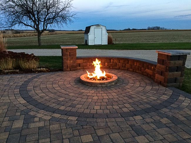 Stone fire pit on a patio surrounded by furniture