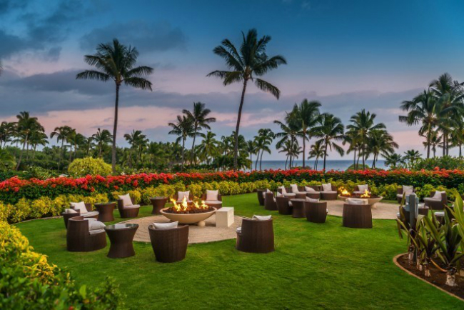 Sunset view of gas fire bowls at a Hawaiian resort