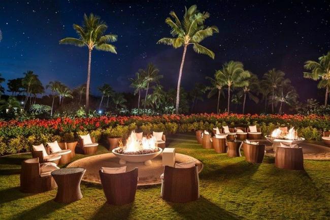 Night view of gas fire bowls at a Hawaiian resort