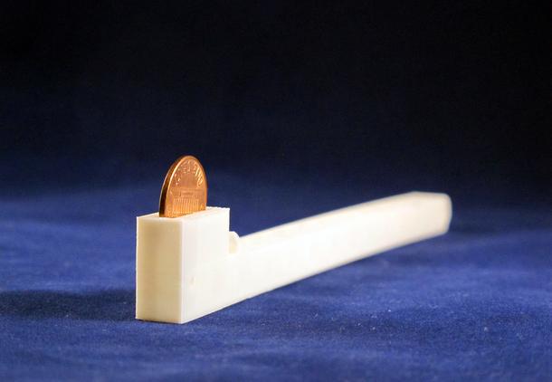 Desktop_Defender_Arm-_Seej: A penny-compatible arm for the Desktop Defender.