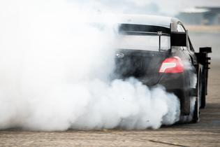 Pastrana gets sideways and turns rubber to smoke in the first test of his Gymkhana STI.