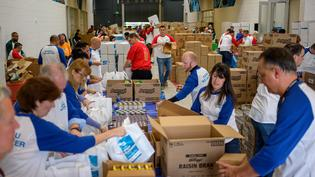 Subaru of America, Inc. employees celebrate donating a record-breaking 15,000 'KidzPacks' to Food Bank of South Jersey.
