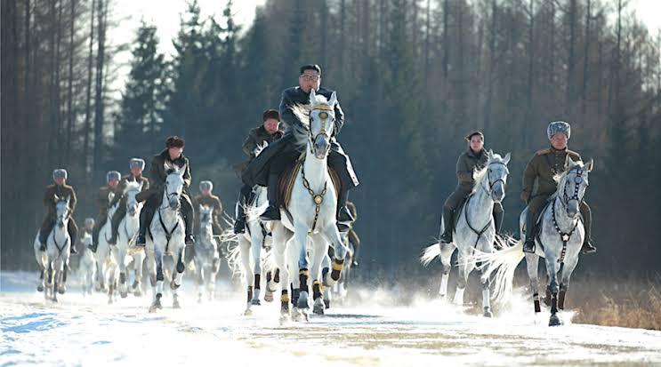 Kim Jong-Un riding a horse with his generals