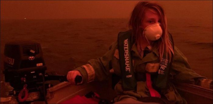 girl driving powerboat to escape the fire