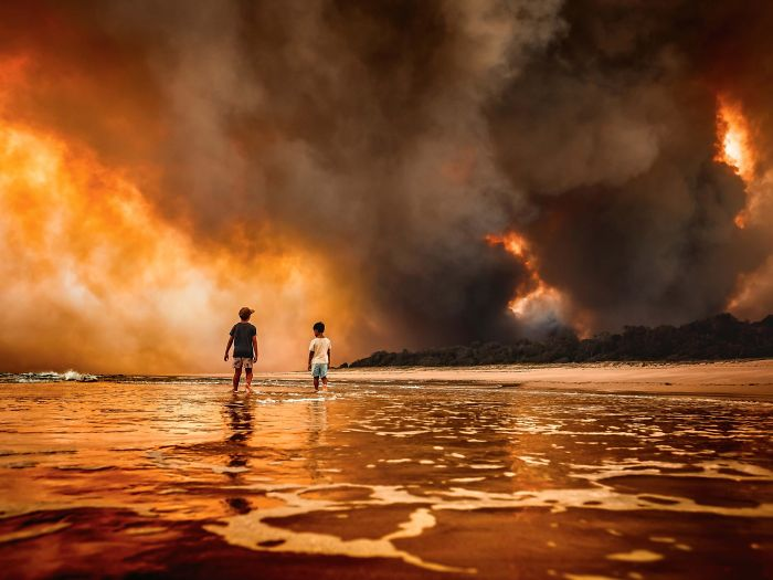 trapped between fires and the ocean