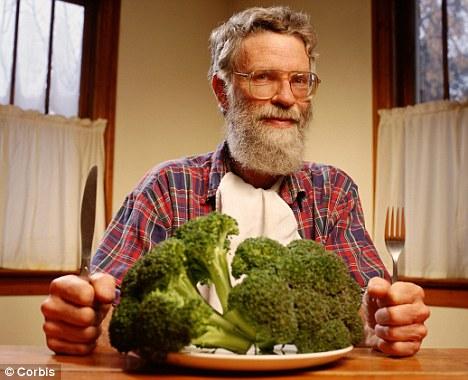 old man eating broccoli