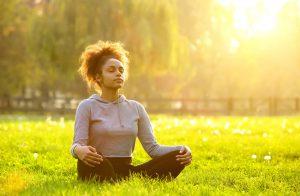 woman doing yoga and deep breathing