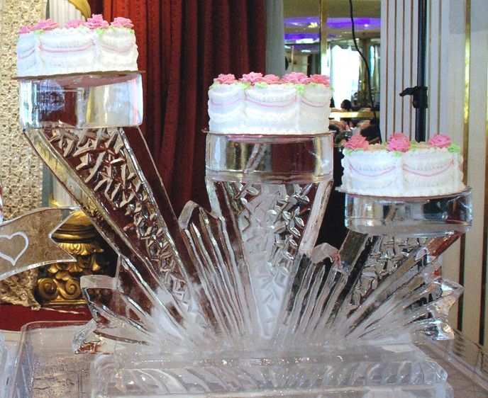 ice sculpture carving wedding birthday  tiered cake .