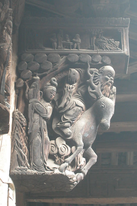 bracket of man on deer with peach and attendant maiden