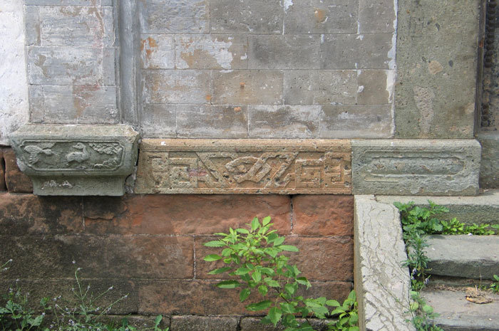 stonework at the base of main entrance