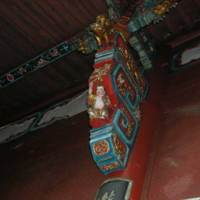 A bracket on the right-hand side decorated with a happy child and a unicorn