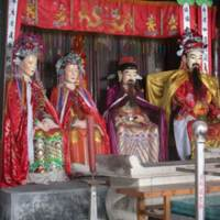 City God parents in the middle accompanied by City God and his wife
