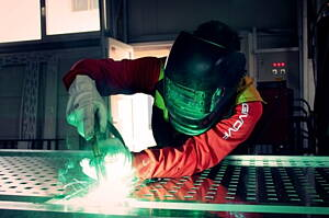 worker welding aluminium