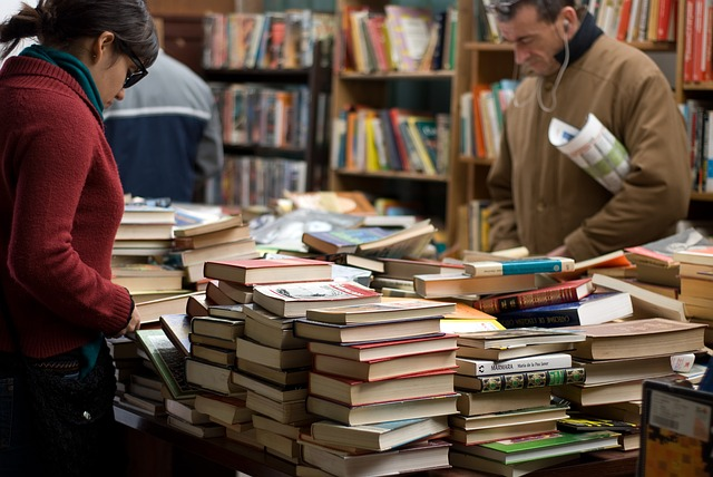 people looking among books in a book store