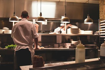 employees working in a comercial kitchen of a restaurant