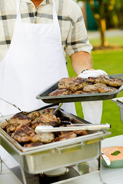 caterer serving meat dishes