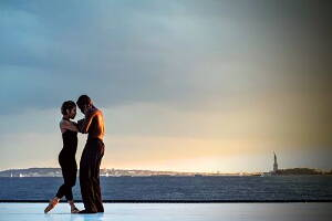 couple dancing close to the sea