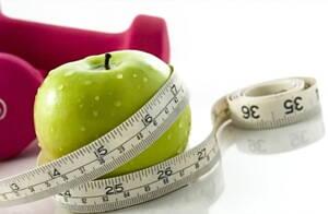 fruta y cinta de medicion