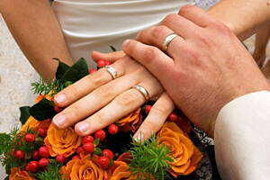 engraved wedding rings upon flowers