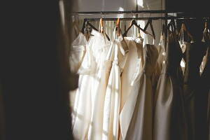 wedding dresses hanging in a wardrobe