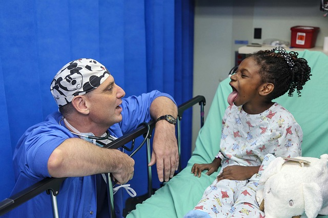 doctor speaking to a little girl in a medical clinic