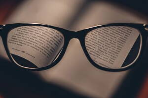 eyes glasses focusing on a book
