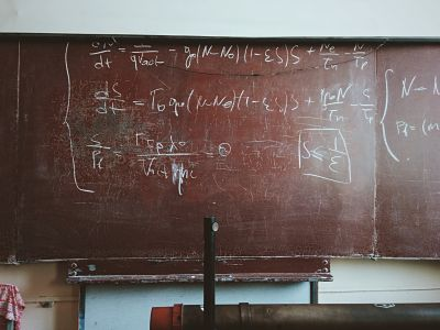 maths theory written on a blackboard at school