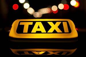 cartel de taxi iluminado