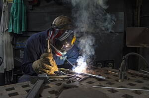 professional welder welding aluminium