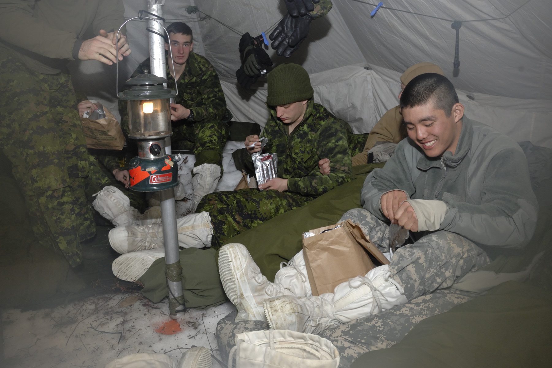 New York Army National Guard Spc Masami Yamakado shares a meal with Canadian Army Reservists during winter warfare training in Canada ( By Cpl Jackson Yee)  sc 1 st  readMedia Newswire & Ice to meet you!: New York City Guard Soldiers Learn Winter ...